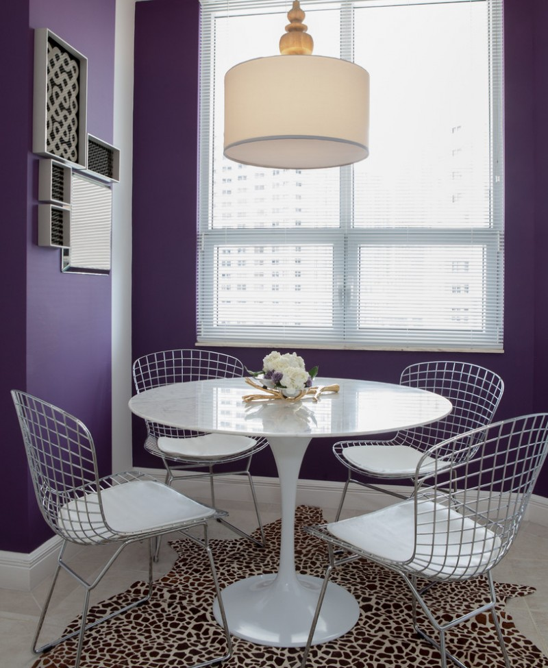 white round top dining table white dining chairs with net backs animal prints area rug white floors purple walls modern pendant