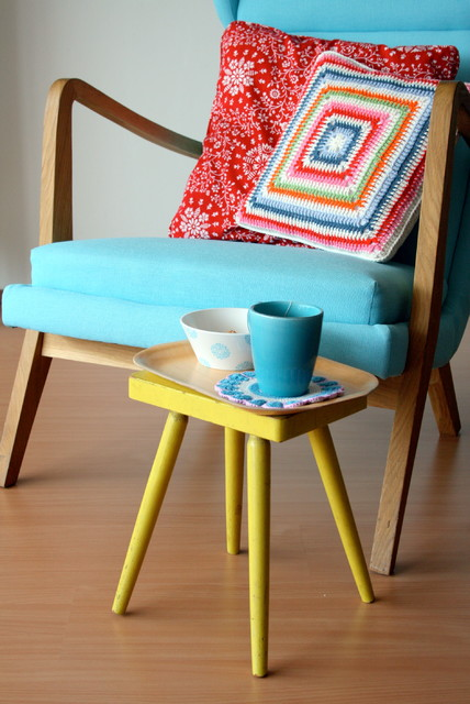 angled legs center table in yellow angled legs chair with wood construction and radiant blue covered foam