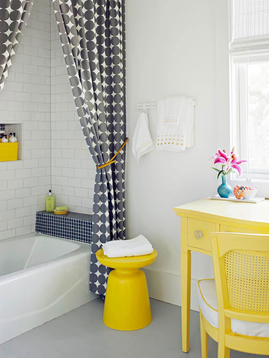 beautiful shower curtains pop of yellow furniture pieces white bathtub white subway tiles walls light grey floors white painted walls