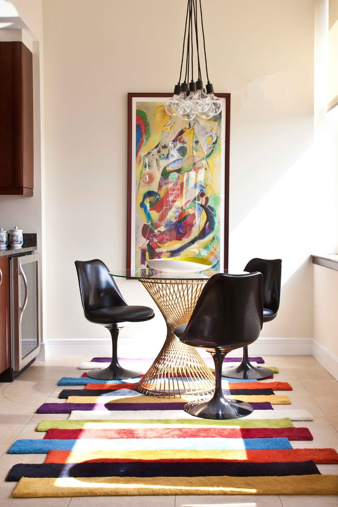 contemporary breakfast nook abstract picture industrial bulb pendants mid century modern plastic chairs in black round top glass table with artistic wood base colorful flanel rug