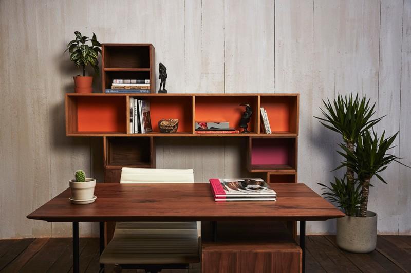 dark wood office furniture pieces medium sized palm tree whitewashed wood siding walls dark wood board floors