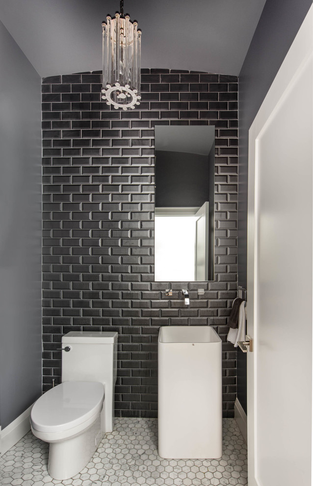 grey painted walls and ceilings solid black tiles wall background white toilet contemporary white sink frameless mirror luxurious crystal pendant