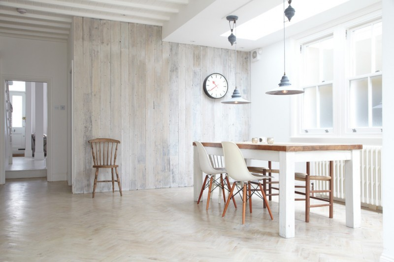 light scandinavian dining room whitewashed wood wall herringbone floors white dining table with wood top angled legs white dining chairs