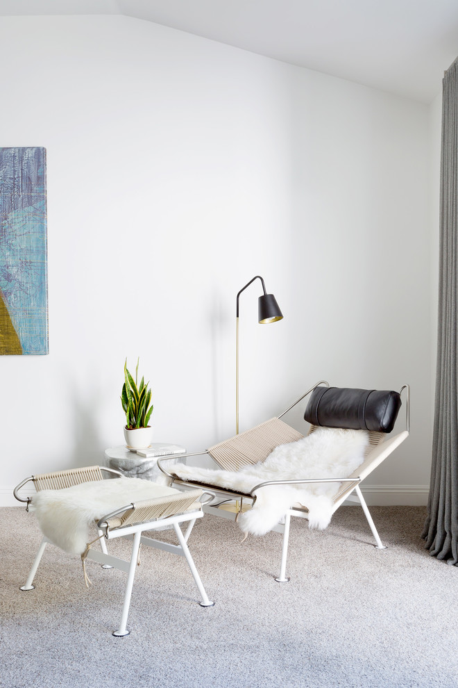 modern reclining chair with black leather neck rest white fury blanket modern table with white fury blanket white area rug tiny floor lamp with black shade
