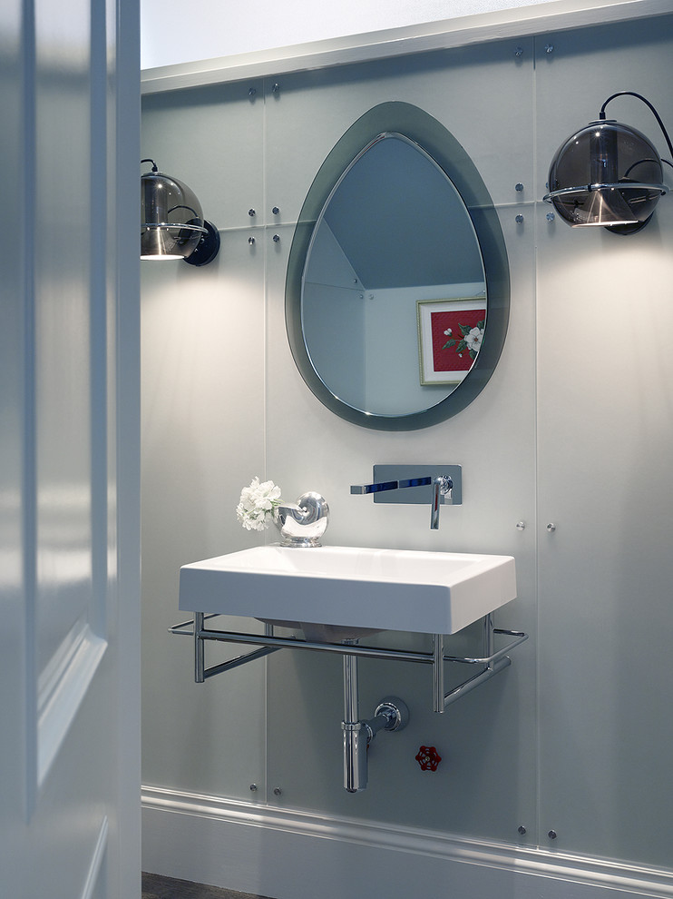 modern vintage powder bath vintage mirror clean lined white sink clean line white walls a pair of chrome wall lamps