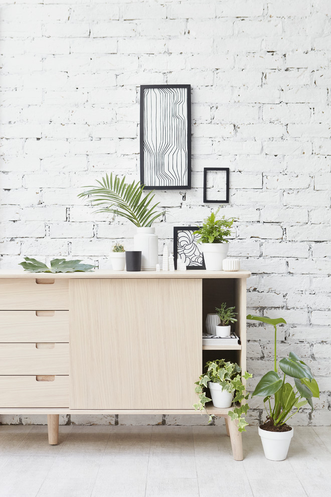 scandinavian hallway idea light wood hall console table white painted brick walls black framed wall decors decorative plants with white planters