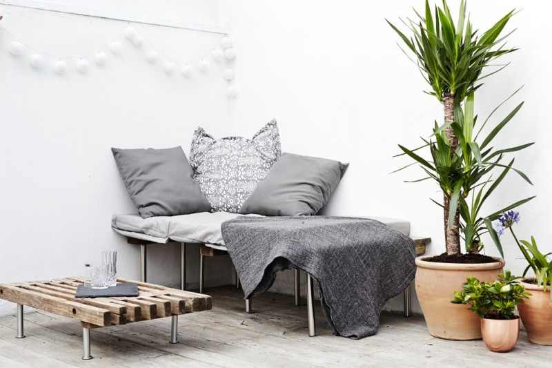 scandinavian terrace shabbier wood bench metal legs bench with grey throw pillows and blanket clay burnt planters