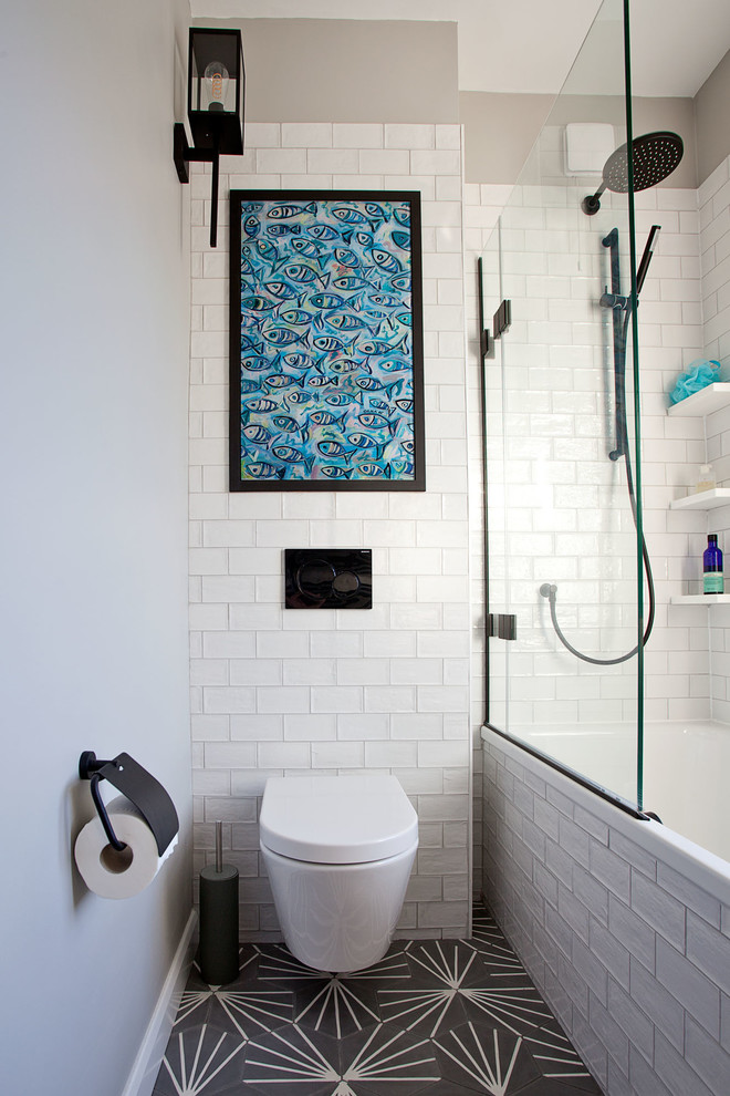 small contemporary bathroom dark tiled floors with motifs floating white toilet artistic blue fish wall art white subway tiles walls