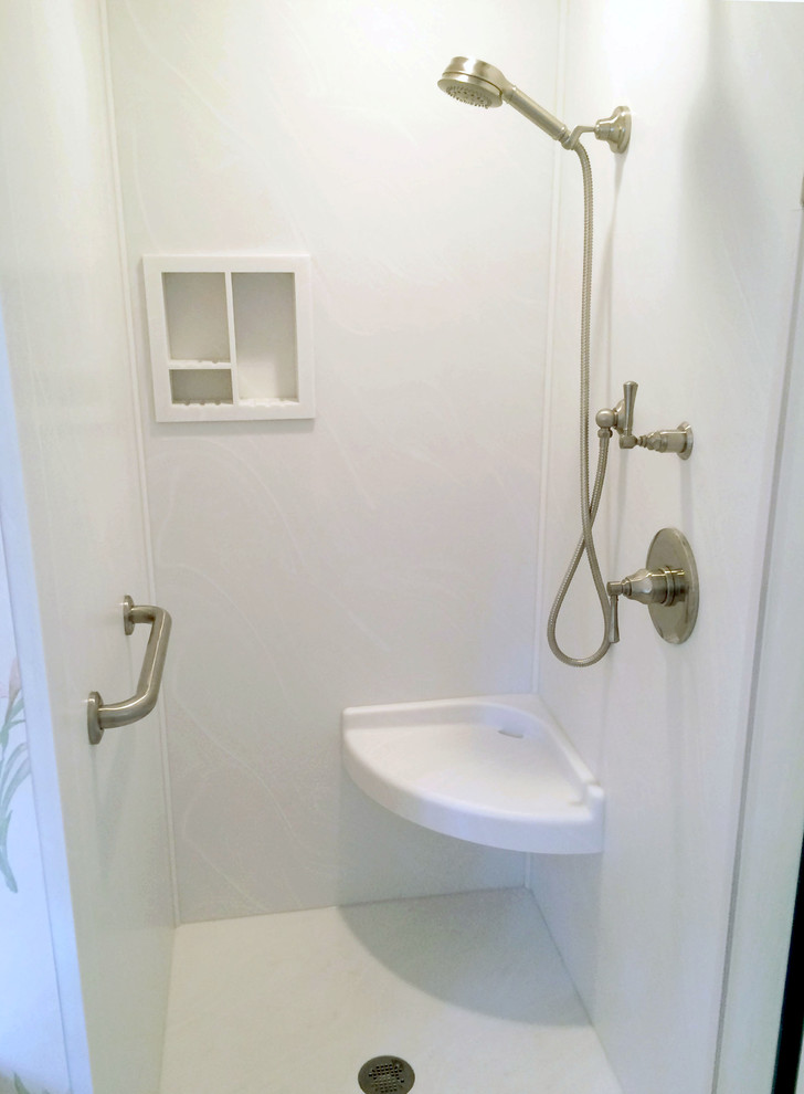 small walk in shower with corner floating shelf recessed shelves and stainles steel shower appliances