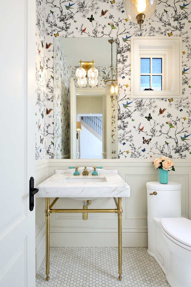 traditional bathroom butterfly wallpaper frameless mirror marble top vanity with undermount sink and gold toned legs white toilet