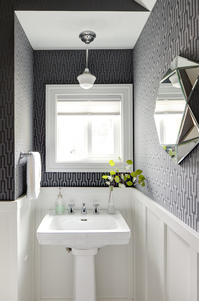 traditional bathroom idea white pedestal sink dark geometric wallpaper white baseboard white pendant
