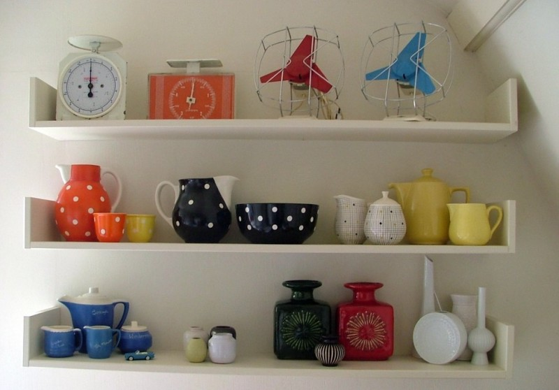 white display shelves decorative cups and teapots