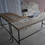 L shaped industrial working desk with two sided counter industrial styled working chair shabby wood walls concrete floors
