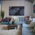 baby blue floor couch in L shape fluffy white area rug creative wall decor small low level coffee table in dark