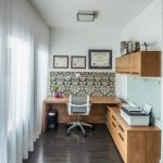 contemporary home office wood finish working desk wood finish cabinets gold floral wallpaper with black colored background dark wood floors