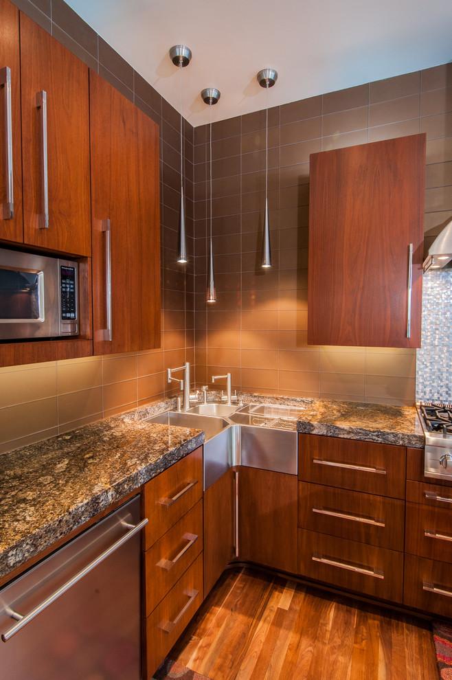 contemporary kitchen idea dark wood cabinets with modern silver handles dark brown tiled backsplash dark granite countertop double corner sink with additional prep sink reclaimed wood floors