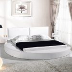 contemporary round platform bed with headboard modern floor lamp with black lampshade white rug area rug