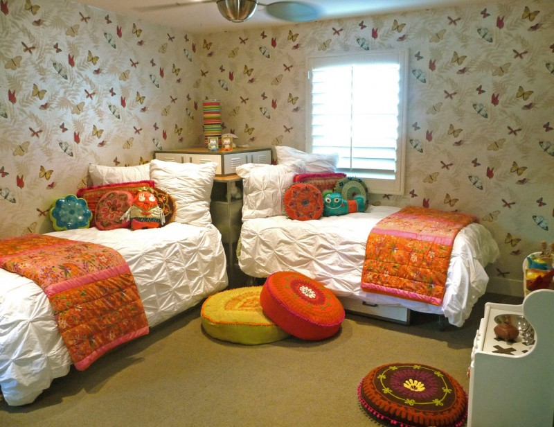 eclectic kids' bedroom traditional twin beds with storage corner block between the beds' head ocolorful butterfly wallpapers white & textured quilts orange comforters