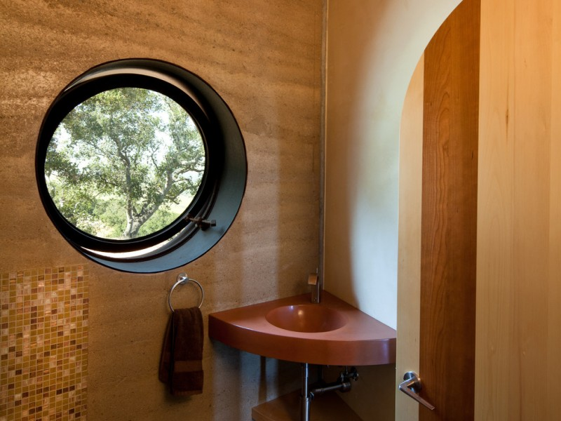 eclectic powder room red heart toned corner sink wooden walls with mosaic addition round glass window with black trim