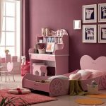 girls bedroom design pink bed frame with heart shaped headboard pink study desk and stool pink heart shaped chairs red rug orange bed mats