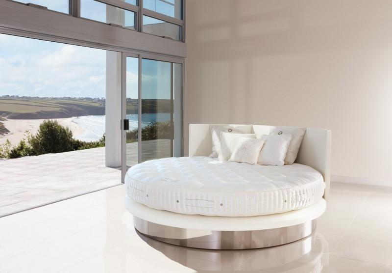 handmade round platform bed frame with curvy headboard