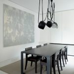 modern dining room black painted dining chairs black painted dining table modern black pendant lamps dark abstract picture beige rug