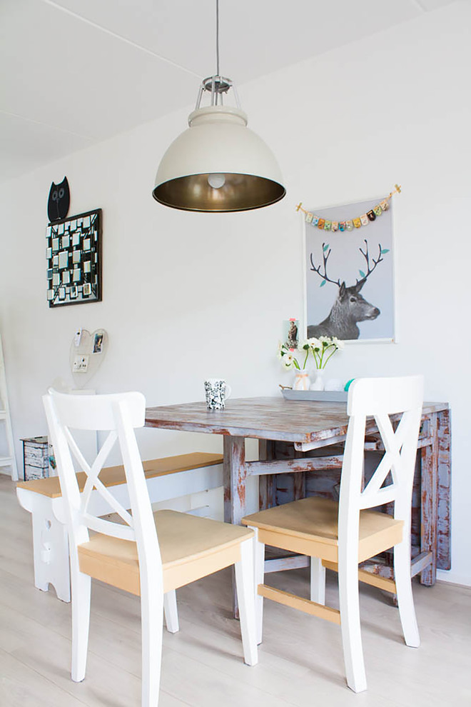 open concept scandinavian dining room light wood dining chairs with white accents light wood dining bench with white accent semi vintage drop leaf table