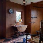rustic entryway rustic drop leaf table vintage area rug yellow black diamond cut tiles floors hardwood walls antique pendant