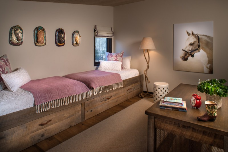 rustic twin beds with storage horse pictures dark wood floors light brown area rug dark wood table