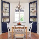 small mediterranean dining room corner cabinets in navy blue traditional chandelier smaller wood dining furniture set terracotta tiled floors