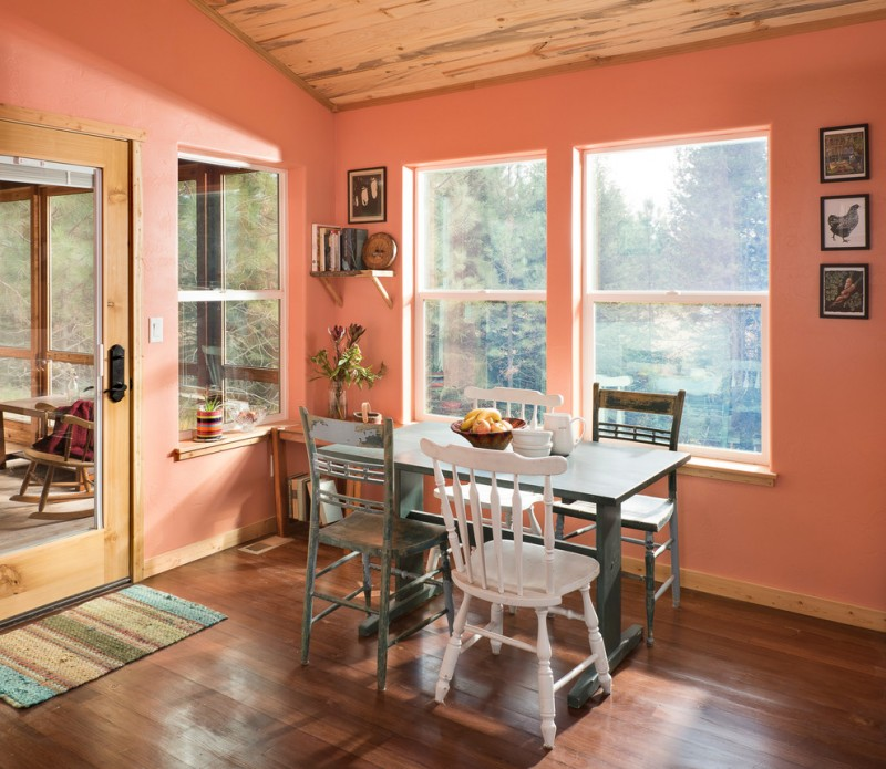small rustic dining room with pink walls shabby wood dining chairs white dining chairs dark finishing dining table dark wood floors medium sized door mat
