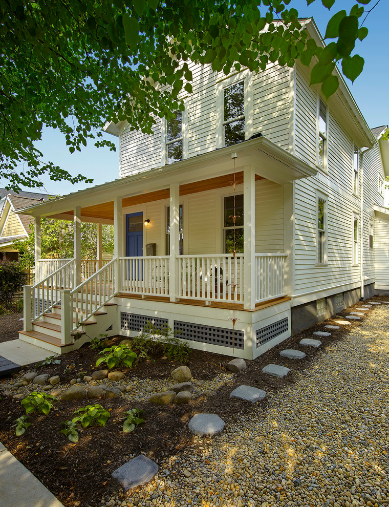 traditional exterior idea white wood siding exterior walls medium toned wood floors exterior stairs with white railings grey accent lattice skirting
