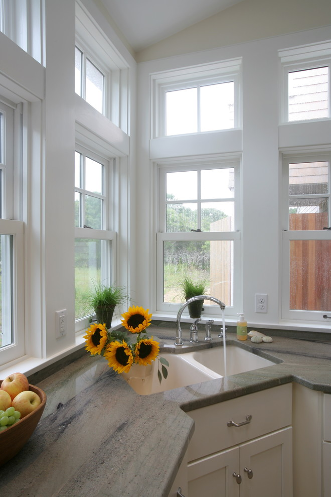 traditional kitchen white double corner sink with total width white granite countertop white cabinets glass windows with white trims