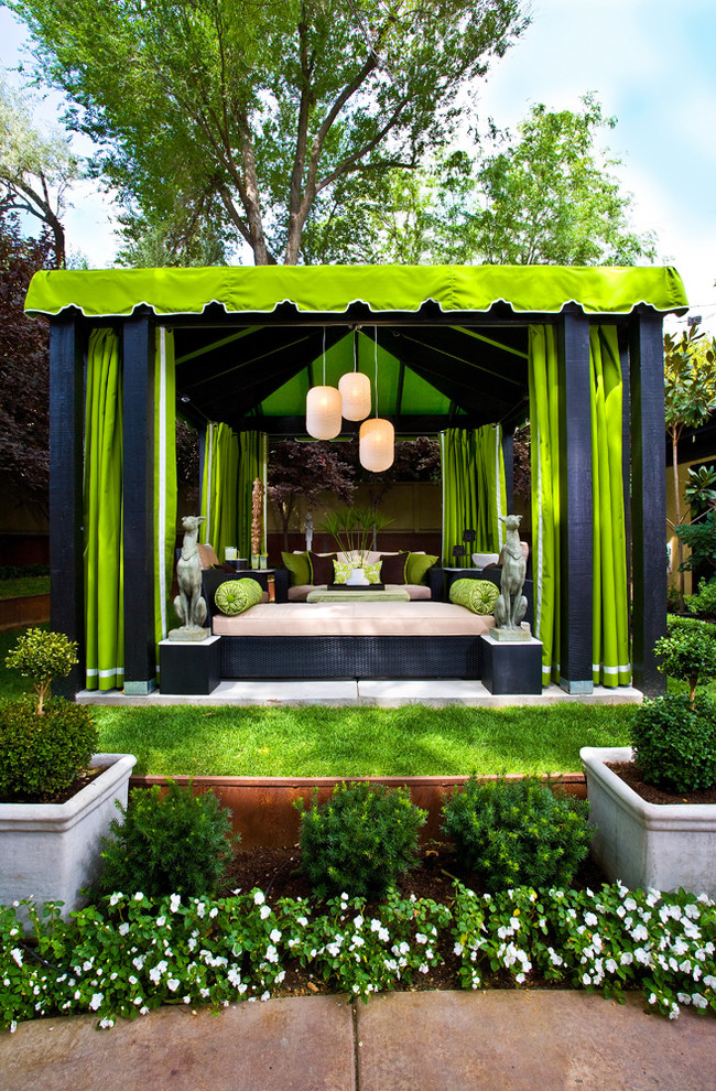traditional patio with vibrant green lime fabric panels and canopy low lighted modern pendants traditional daybed