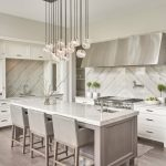 transitional kitchen idea marble top kitchen island with undermount sink and grey leather finish stools