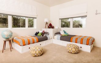 transitional twin XL bed with storage and corner block in white stripped orange bedding treatment light orange beanbags with geometric patterns decorative globe