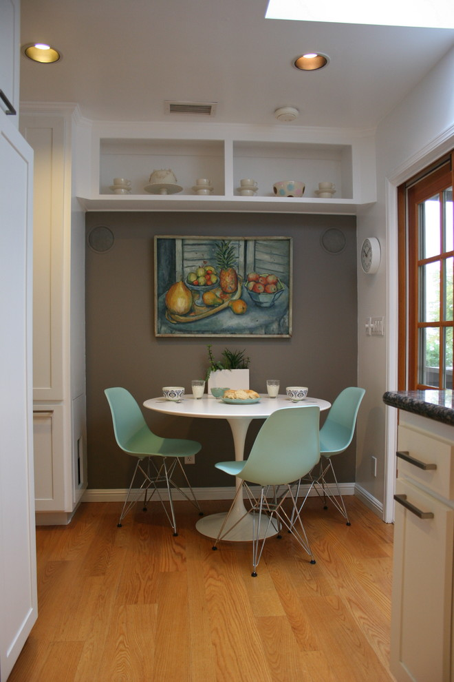 trendy breakfast nook grey painted walls handmade painting accent dining furniture set consisting light turquoise plastic chairs white round top table medium toned wood floors
