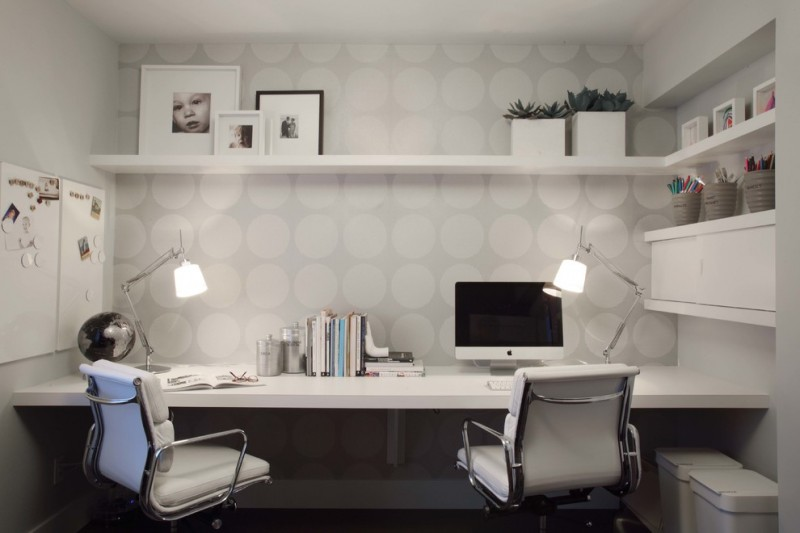 trendy & small home office neutral dots wallpaper built in working desk in white modern working chairs with wheels open shelf in white