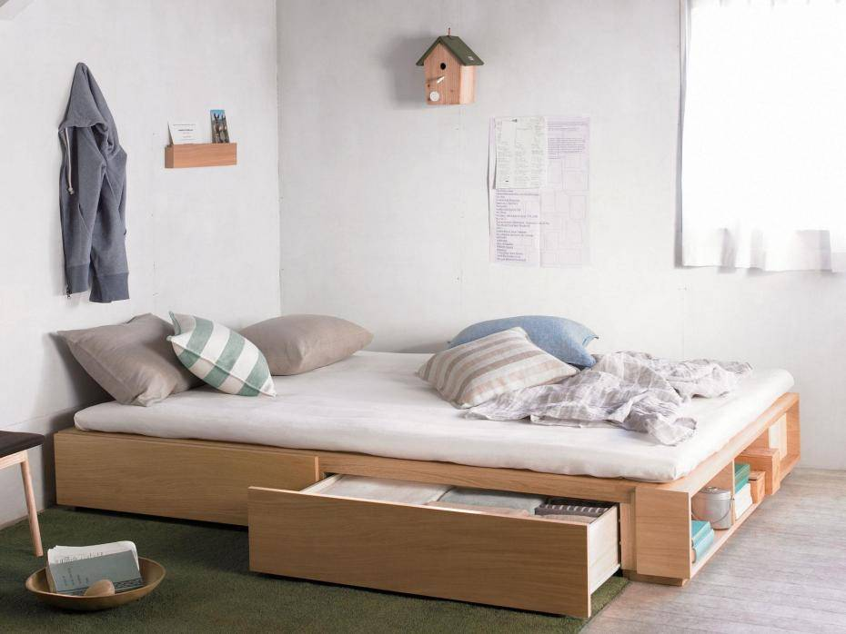 twin oak bed with storage white futon multicolored pillows green rug
