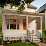 victorian front porch design with wood board rails in white exterior staircase with black stained metal railings ventilated porch skirting in white