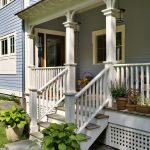 white finished lattice porch skirting idea white painted railings and pillars wood floors light blue wood siding exterior walls