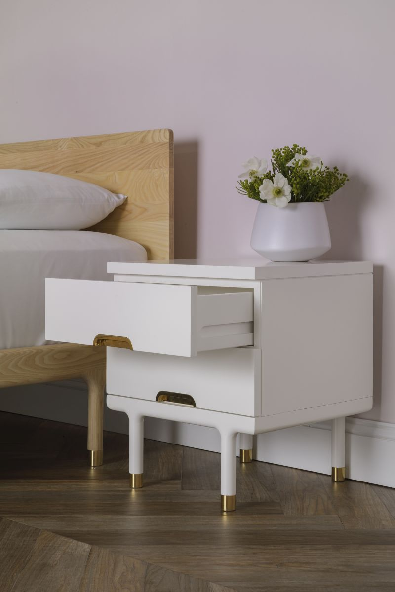 white finishing side table with gold accents on legs and drawers' bottom