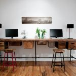 wood reclaimed two sided working desk with additional custom vintage crate cabinets stools with reclaimed wood top and piped base