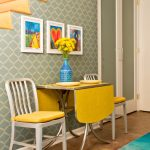 yellow drop leaf table with chrome accent yellow white chairs light blue wallpaper with modern patterns hand painted wall decors