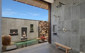 Bali inspired bathroom design textural gray walls with recessed shelves small sized outdoor pool small wooden bench sea grass limestone floors