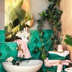 Bohemian Inspired Bathroom With Greenery Bathroom Vanity With Metal Base And White Sink