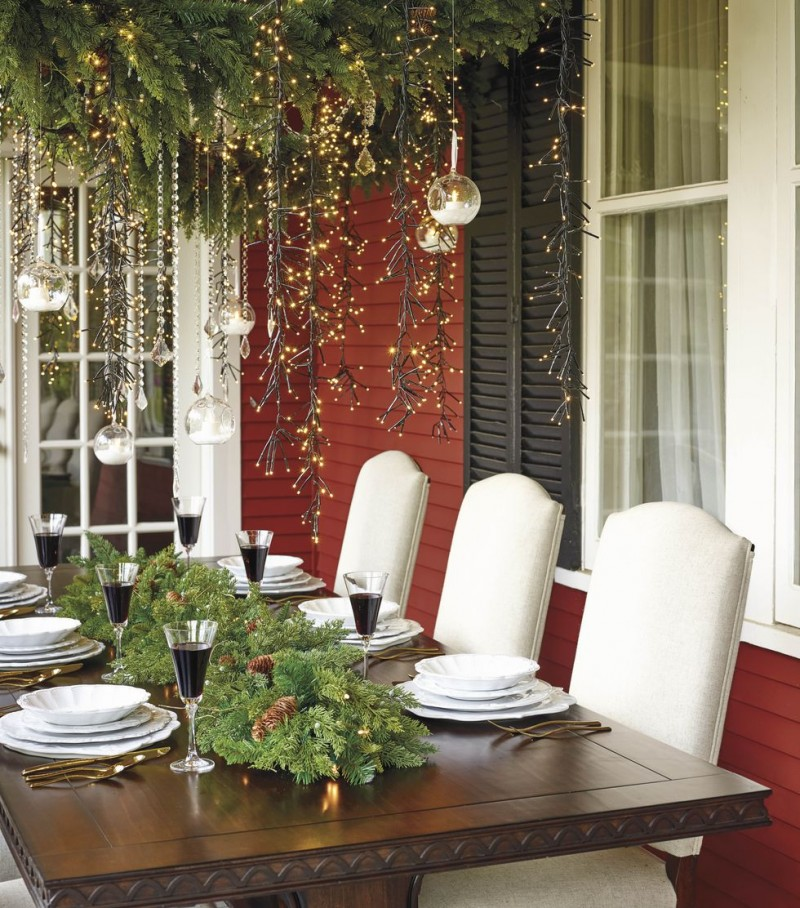Christmas dining set with green centerpiece and hanging arrangement
