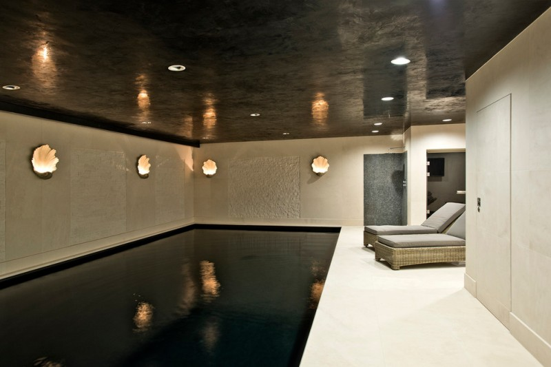 black and white modern indoor pool idea unique wall lamps with warm toned light effect