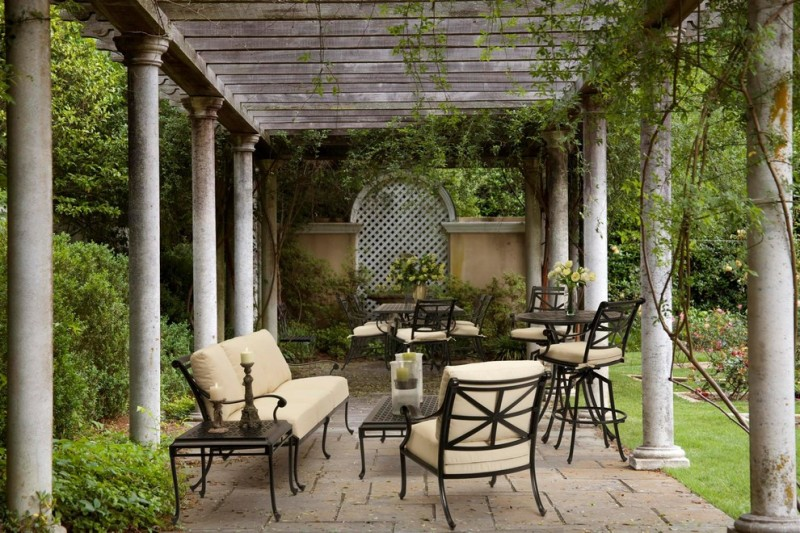 classic patio idea with classic English style enclosure black wrought iron furniture with foamed backs and seats