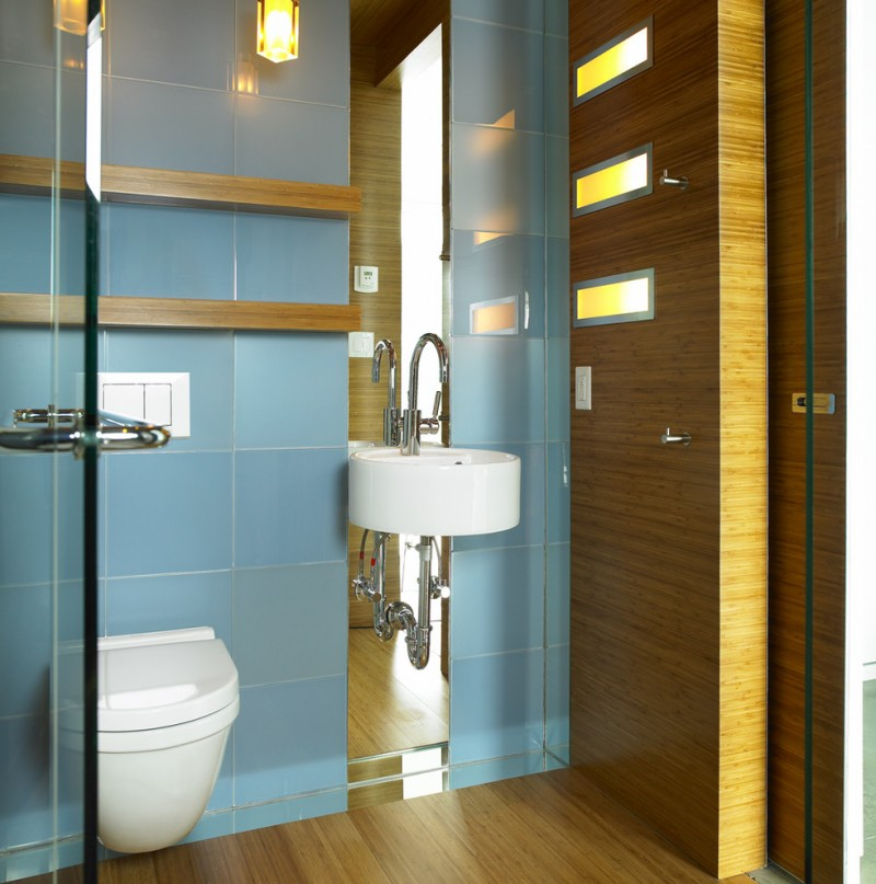 contemporary bathroom design matte bamboo finishing walls and floors blue ceramic tiled walls wall mounted sink in white wall mounted toilet
